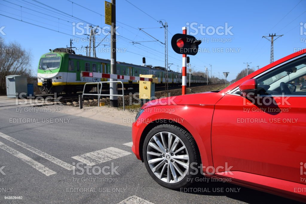 Modern car waiting on the railroad crossing stock photo