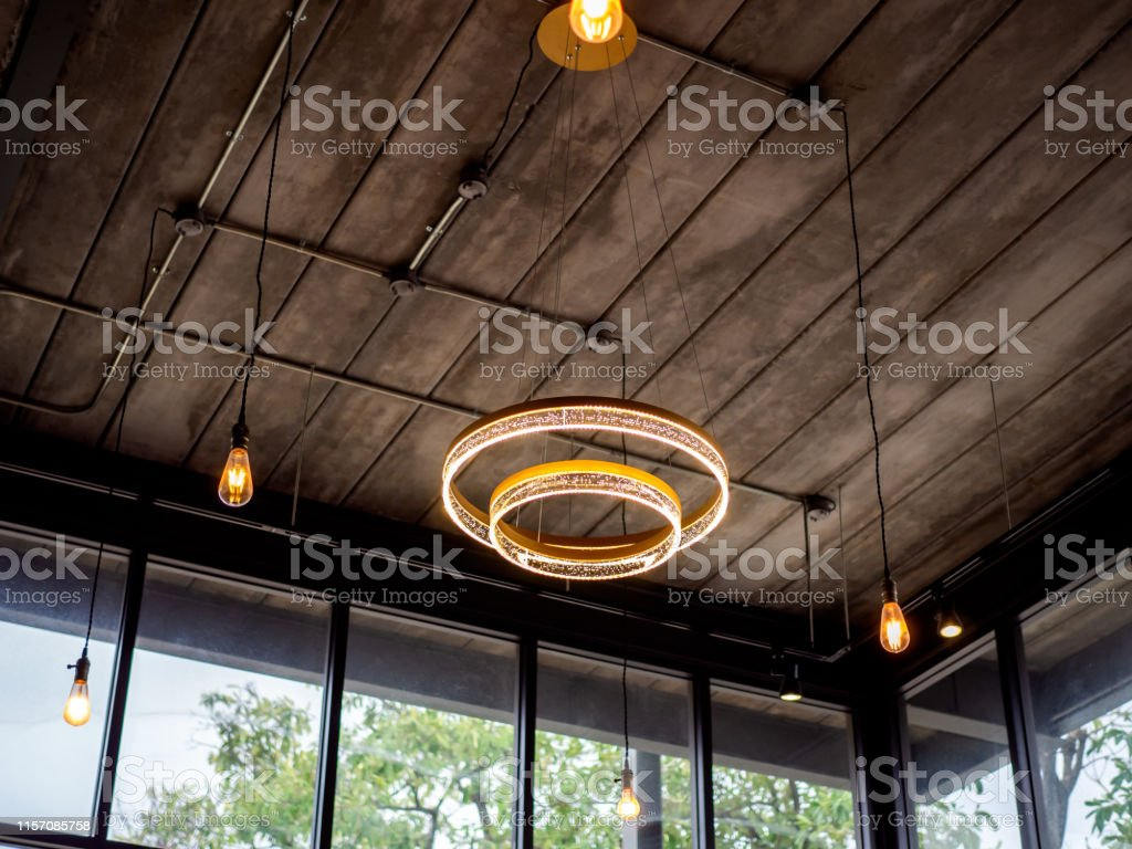 Modern Ceiling Light And Light Bulbs Hanging From Wooden Ceiling In Loft Style Building Stock Photo Download Image Now Istock