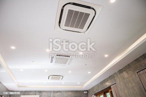 1132163701 istock photo Modern ceiling mounted cassette type air conditioning system 1062960896