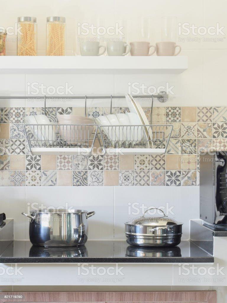 modern ceramic kitchenware and utensils on the black granite counter top stock photo