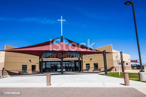 istock Modern Church With Large White Cross 1209299335