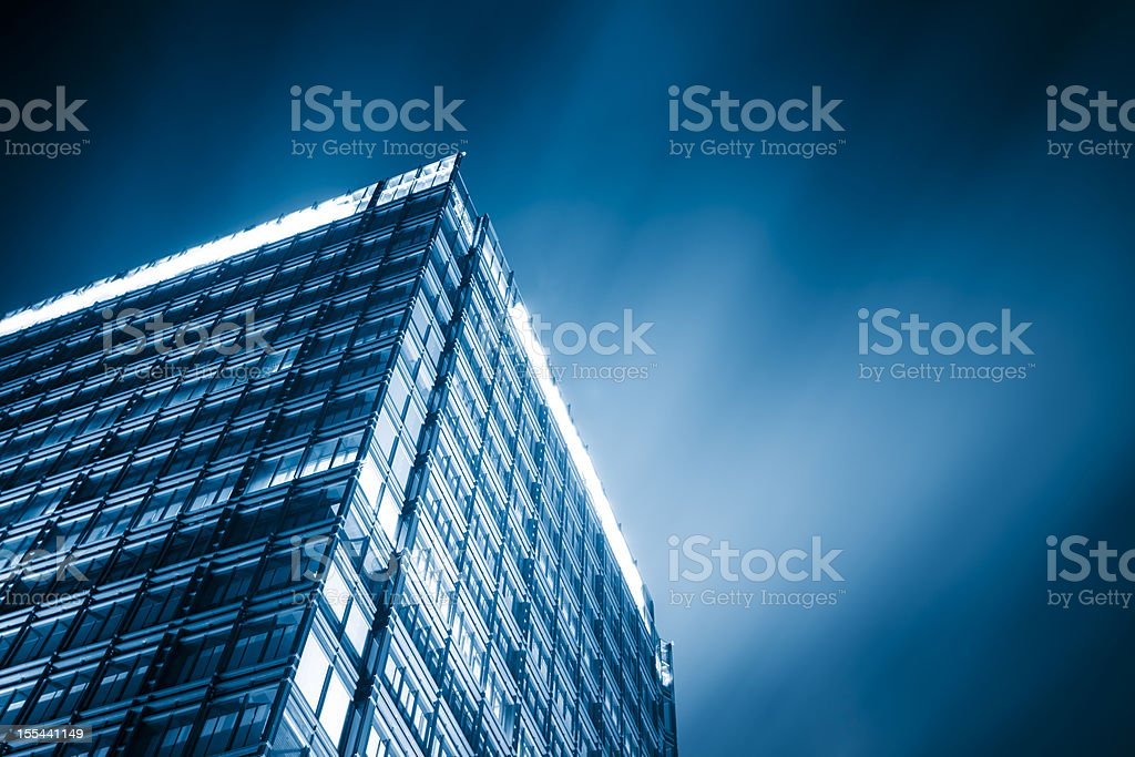 Modern city at night with moving clouds royalty-free stock photo
