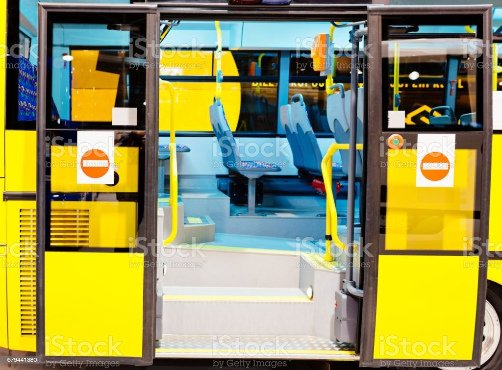Modern city bus entrance with open doors stock photo