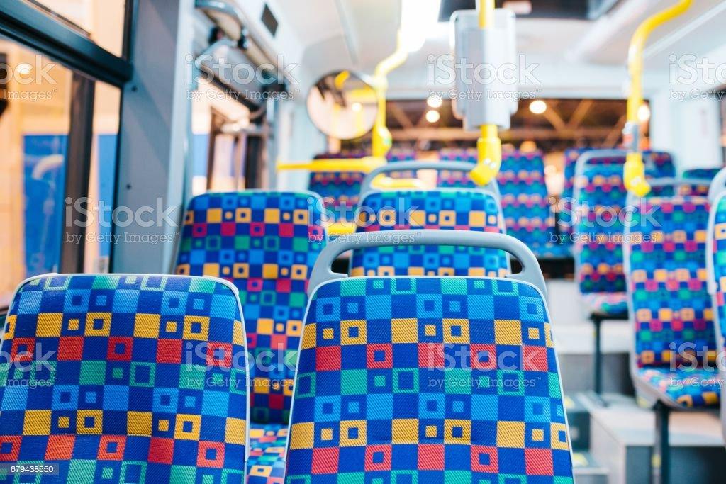 Modern city bus interior and seats - foto de stock