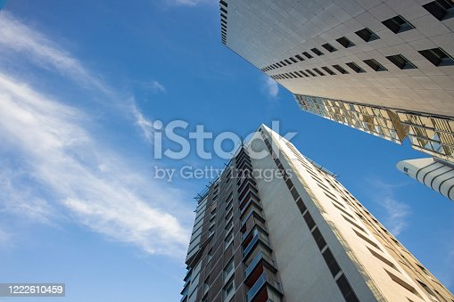 modern city common living building apartment exterior facade construction shape perspective  foreshortening from below on day time blue sky background view