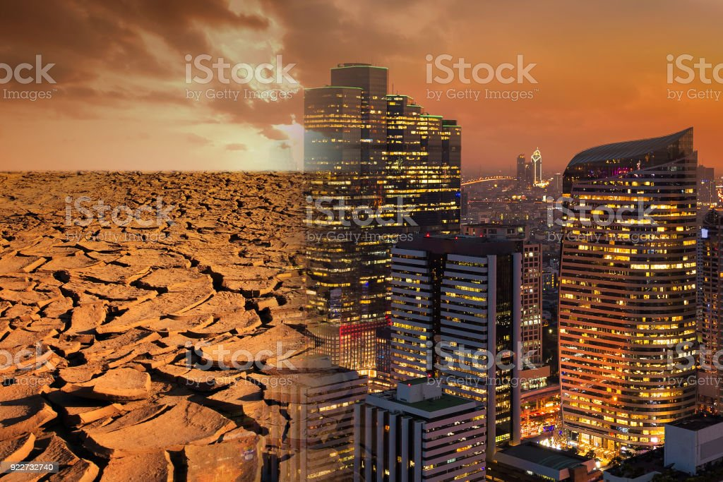 Modern city looks over a cracked earth landscape for global Warming and pollution theme concept stock photo