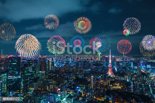 istock modern city night view and skyrocket fireworks 668583122