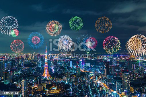 istock modern city night view and skyrocket fireworks 668583144