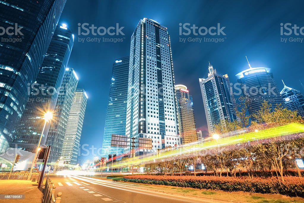 modern city of shanghai at night stock photo