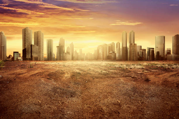 Modern city showing the effect of climate change Modern city showing the effect of climate change impact to the dry land destruction stock pictures, royalty-free photos & images