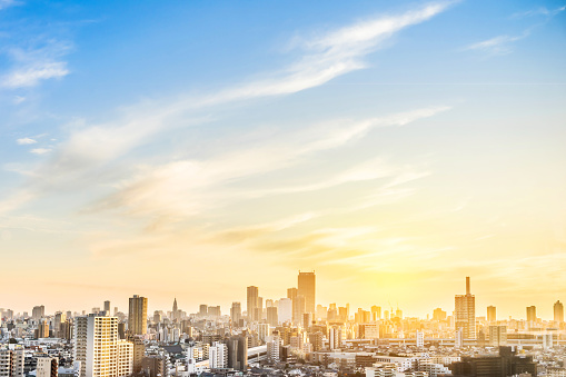 Asia Business concept for real estate and corporate construction - panoramic modern city skyline aerial view of shinjuku area with shinkansen railway under sunset sky in Tokyo, Japan
