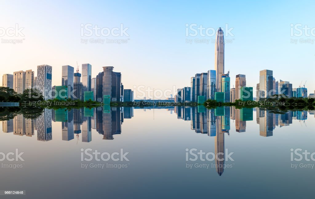 Modern city skyline and water reflection in Shenzhen at sunrise - Royalty-free Architecture Stock Photo