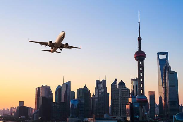 skyline della città moderna con aeroplano - asia orientale foto e immagini stock