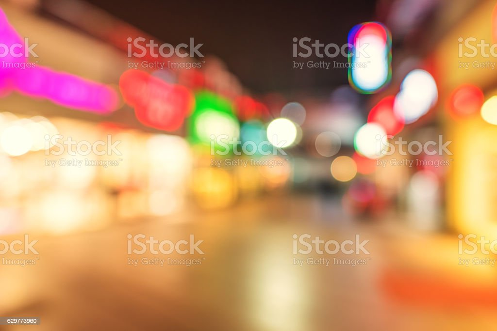 Modern city street at night defocused abstract background stock photo