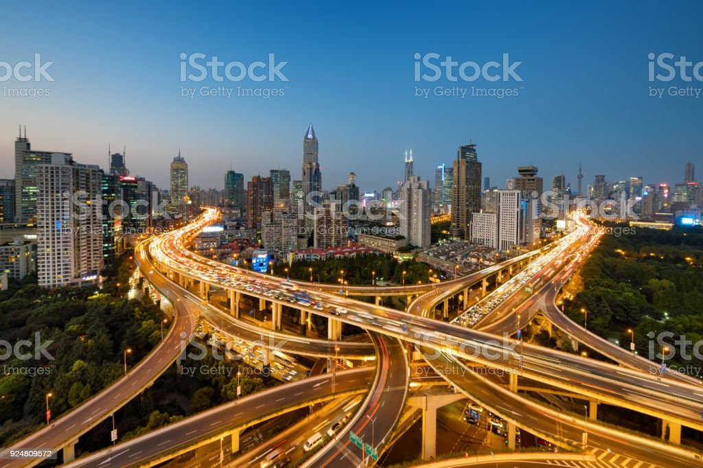 Modern city with highway interchange in Shanghai, China. stock photo