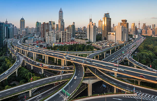 modern city with highway interchange modern city with highway interchange in shanghai ,China overpass road stock pictures, royalty-free photos & images