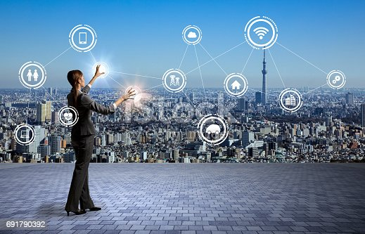 872677426 istock photo modern cityscape and business person, Internet of Things, Information Communication Technology, abstract image visual 691790392