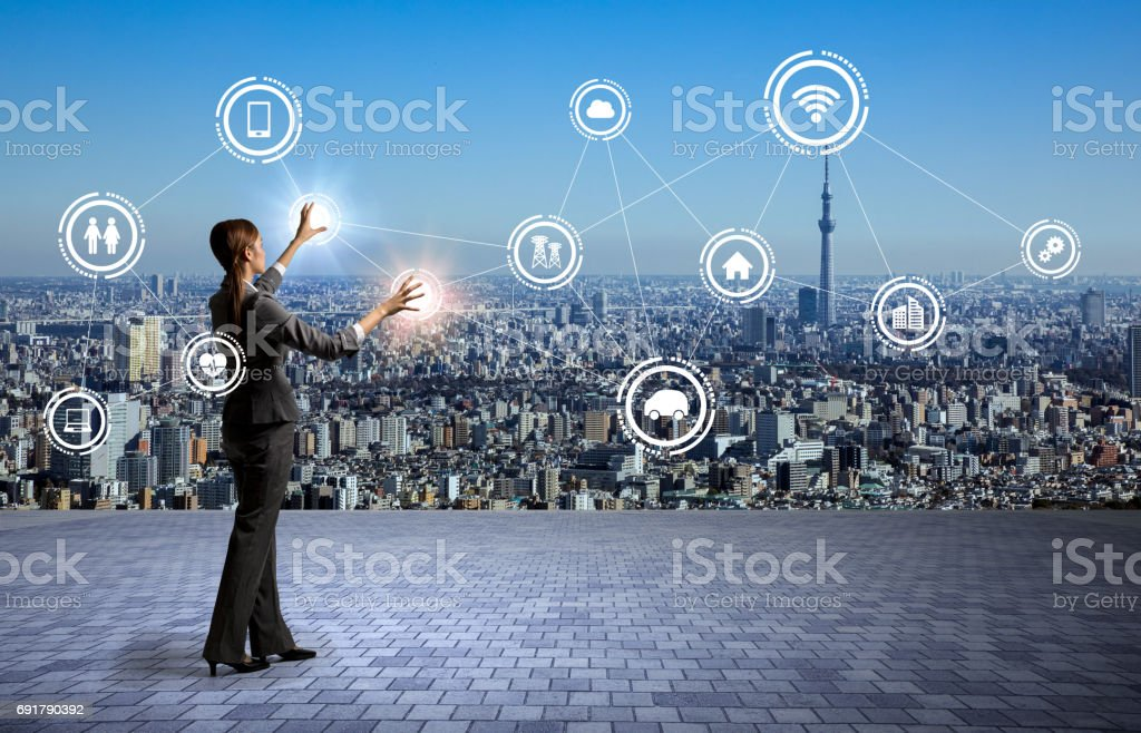 modern cityscape and business person, Internet of Things, Information Communication Technology, abstract image visual stock photo