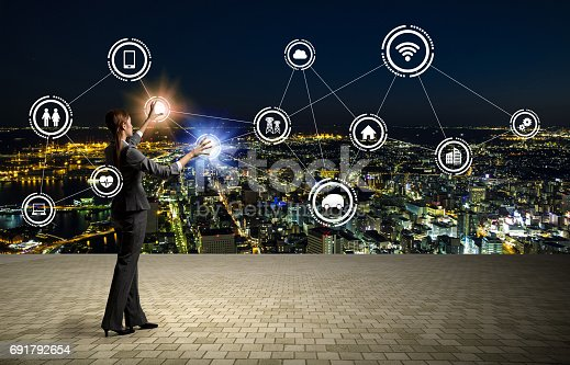 872677426 istock photo modern cityscape and business person, Internet of Things, Information Communication Technology, abstract image visual 691792654