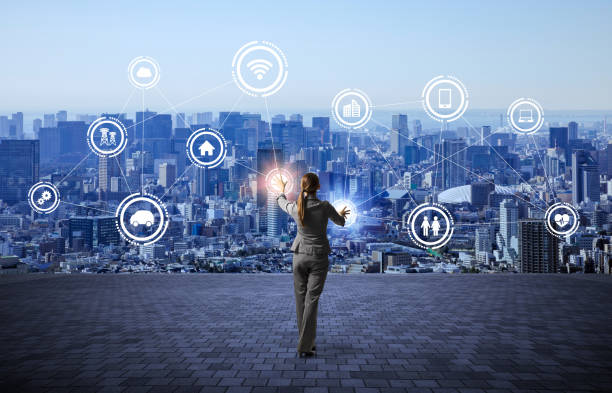 modern cityscape and business person, IoT(Internet of Things), ICT(Information Communication Technology), abstract image visual stock photo