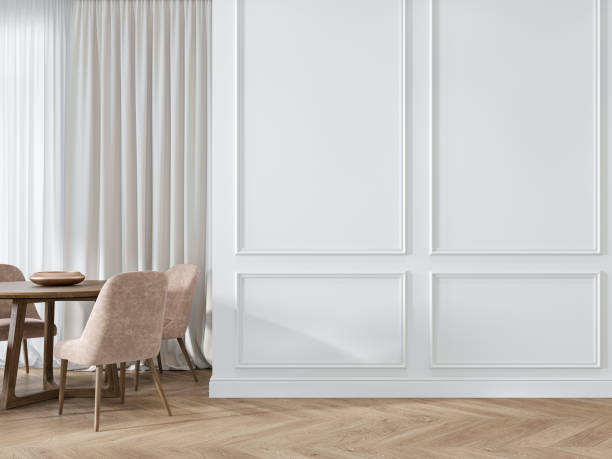 Modern classic white interior with moldings, panelling, dinner table, pink chairs, wood floor. Modern classic white interior with moldings, panelling, dinner table, pink chairs, wood floor. 3d render illustration mock up. neo classical stock pictures, royalty-free photos & images