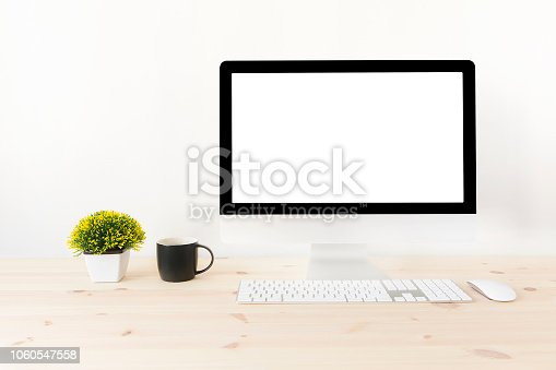 Modern clean workspace mockup with blank screen desktop computer