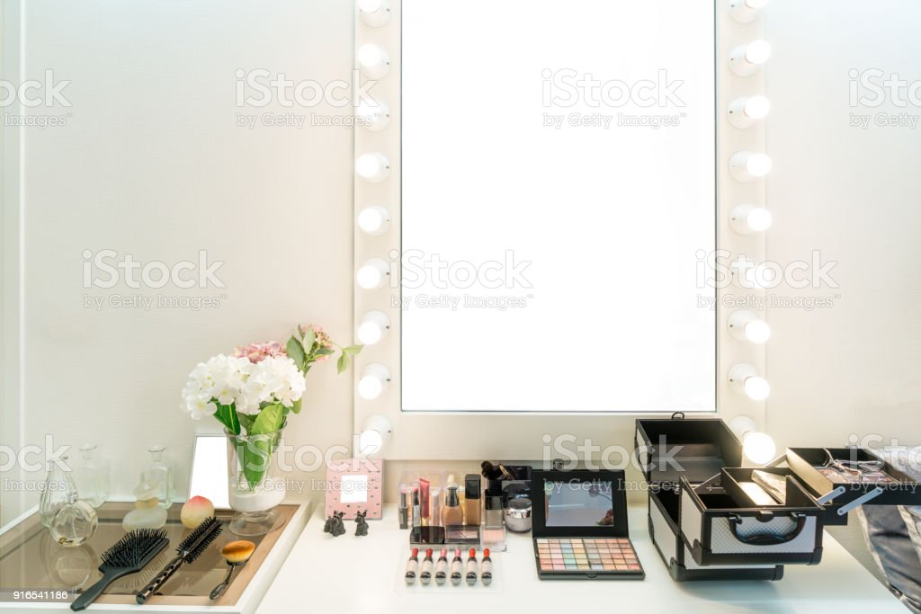 Modern closet room with make-up vanity table, mirror and cosmetics product in flat style house. stock photo