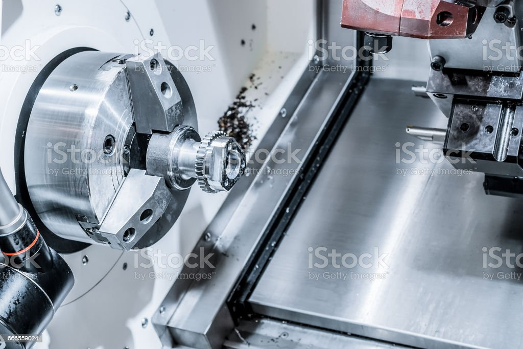 A modern CNC machining center processes the part stock photo