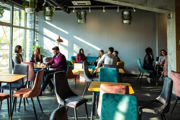 Modern coffee shop with customers picture id1161558546?b=1&k=6&m=1161558546&s=612x612&w=0&h=9rbx5fqgy5cbpvydk3b1ca 8syuojyvldyvunaw0b2u=