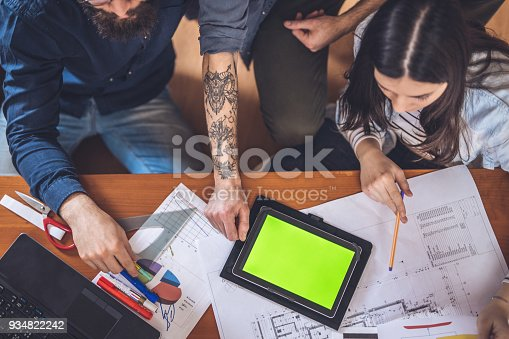 557608497istockphoto Modern colleagues working together 934822242