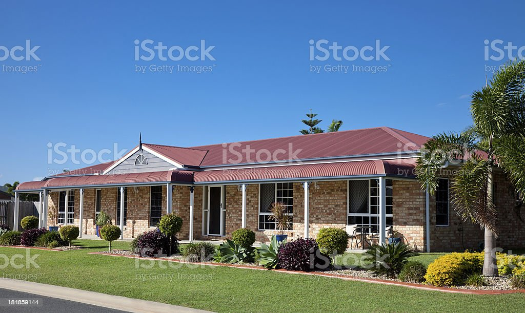 Modern Colonial Home with blue sky stock photo