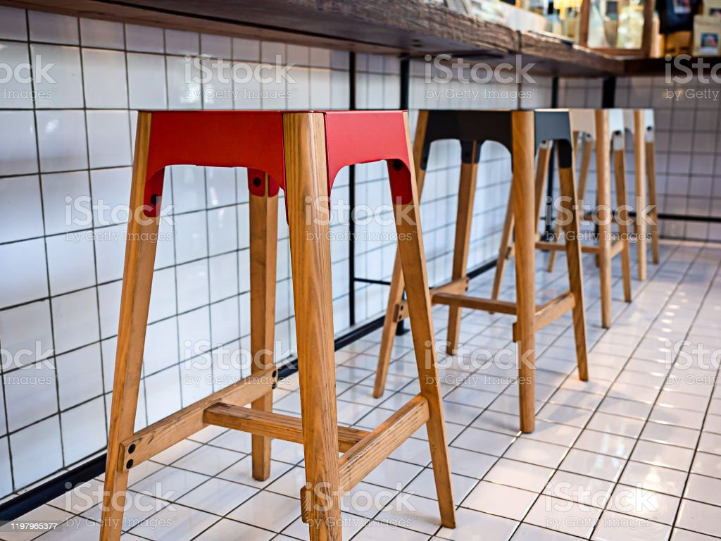 Image of: Modern Colorful Wooden Chairs Or Bar Stools Under Wooden Bar On White Mosaic Background In Cafe Stock Photo Download Image Now Istock