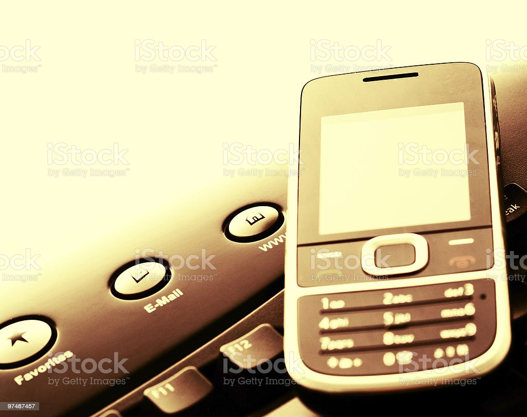 Modern communication - mobile phone and e-mail royalty-free stock photo