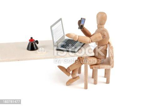 istock modern communication - wooden mannequin at work 183781477
