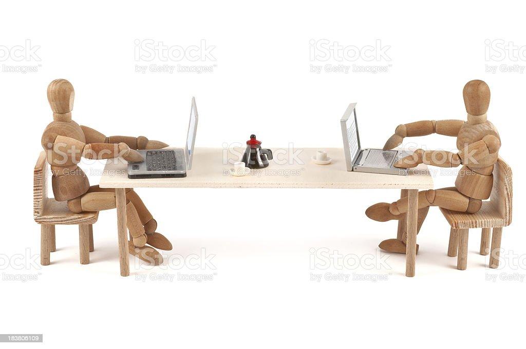 modern communication - wooden mannequin at work stock photo
