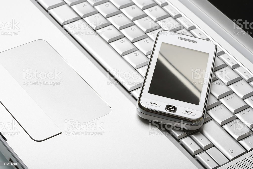 Modern communications concept. White communicator on silver lapt royalty-free stock photo