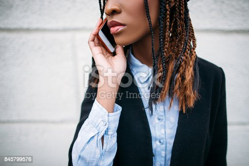 Modern communications. Fashion beauty closeup. Unrecognizable black girl portrait, African American woman on white background, technology concept