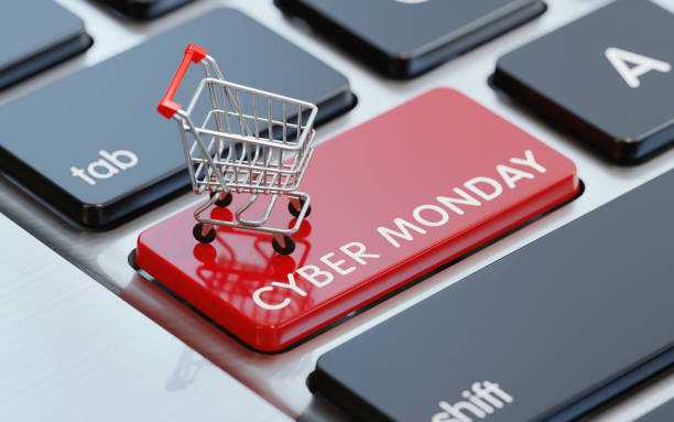 modern computer keyboard with a shopping cart on a cyber monday button - cyber monday стоковые фото и изображения