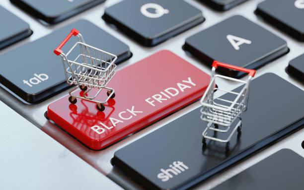modern computer keyboard with a shopping carts on a black friday button - black friday zdjęcia i obrazy z banku zdjęć