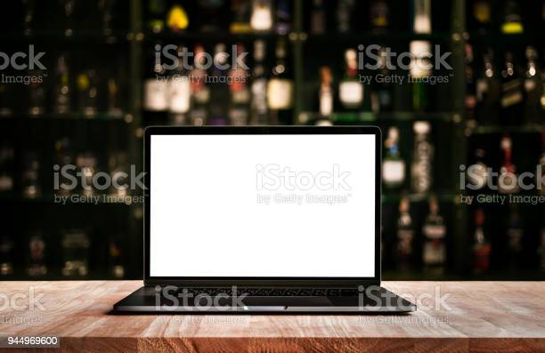 Modern computerlaptop on counter bar with blur wine bottle picture id944969600?b=1&k=6&m=944969600&s=612x612&h=mhfkchneclfdcrb3js9sbscqsft2qz25g ug4yxs6zs=