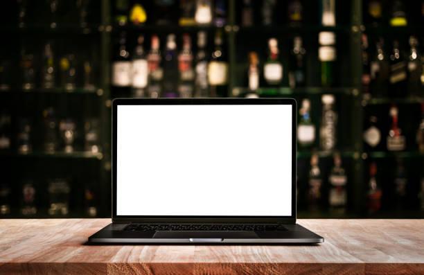 Modern computerlaptop on counter bar with blur wine bottle picture id944969600?b=1&k=6&m=944969600&s=612x612&w=0&h=s0xci fhvlxknnpj6w2xybkcfou7bsqepgjj1ydasra=