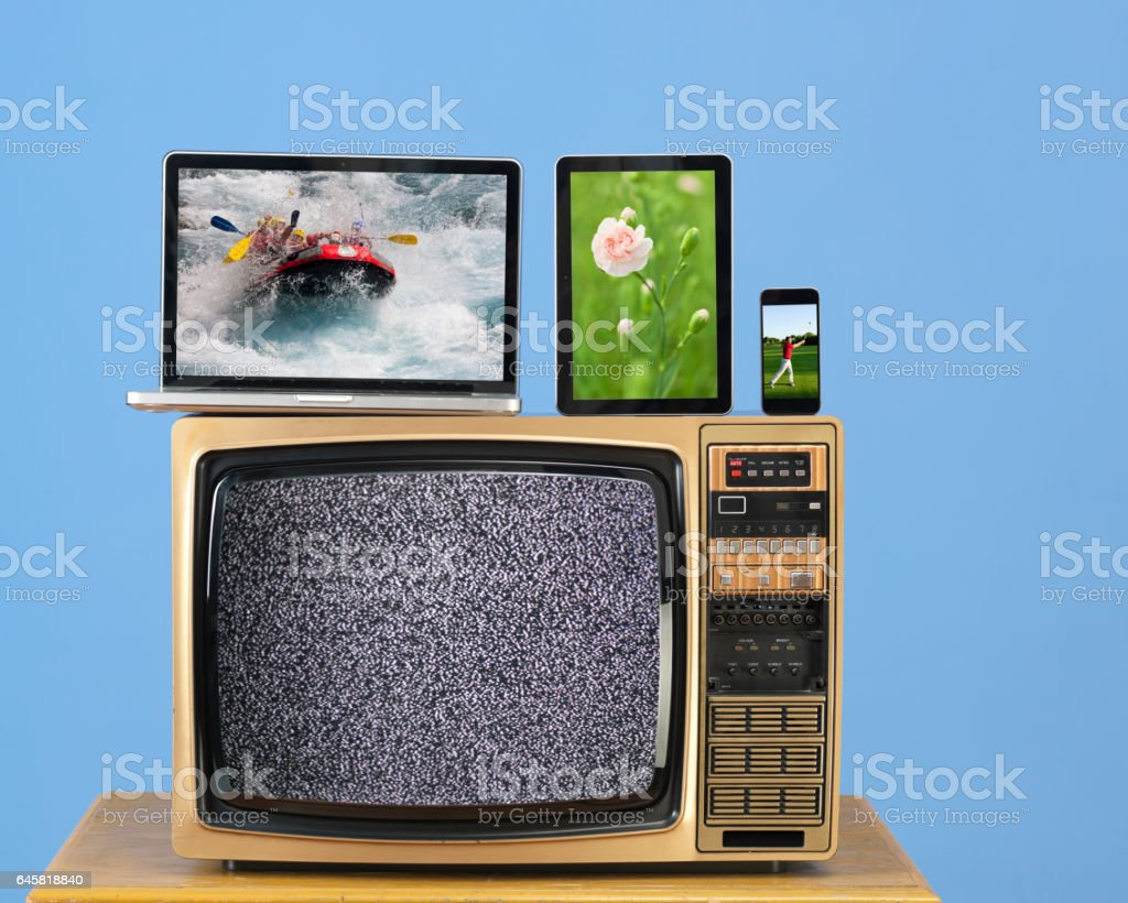 Modern Computer,Smartphone And Tablet Pc On Old Fashioned TV stock photo