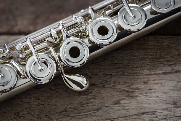 Modern Concert Flute on a Wood Table stock photo