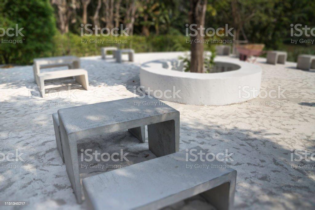 Modern concrete style furniture in outdoor garden, stock photo