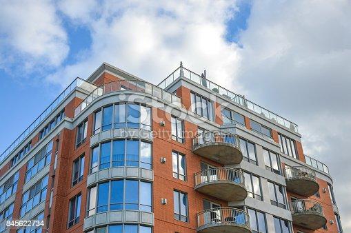 istock Modern condo buildings with huge windows 845622734