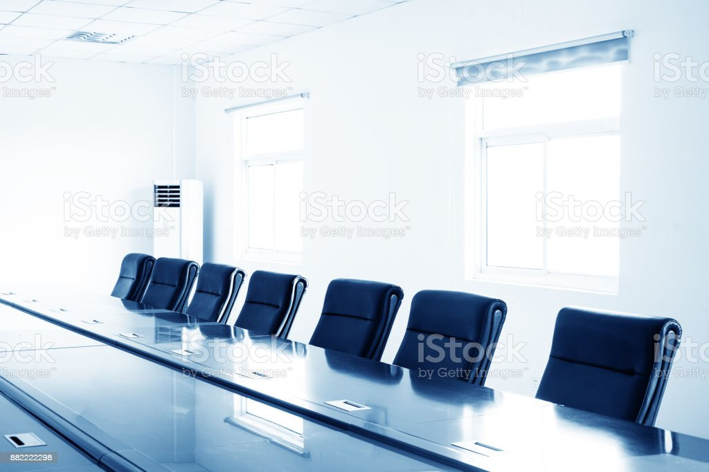 Modern conference room with furniture, laptops, big windows and city view 3D Render stock photo