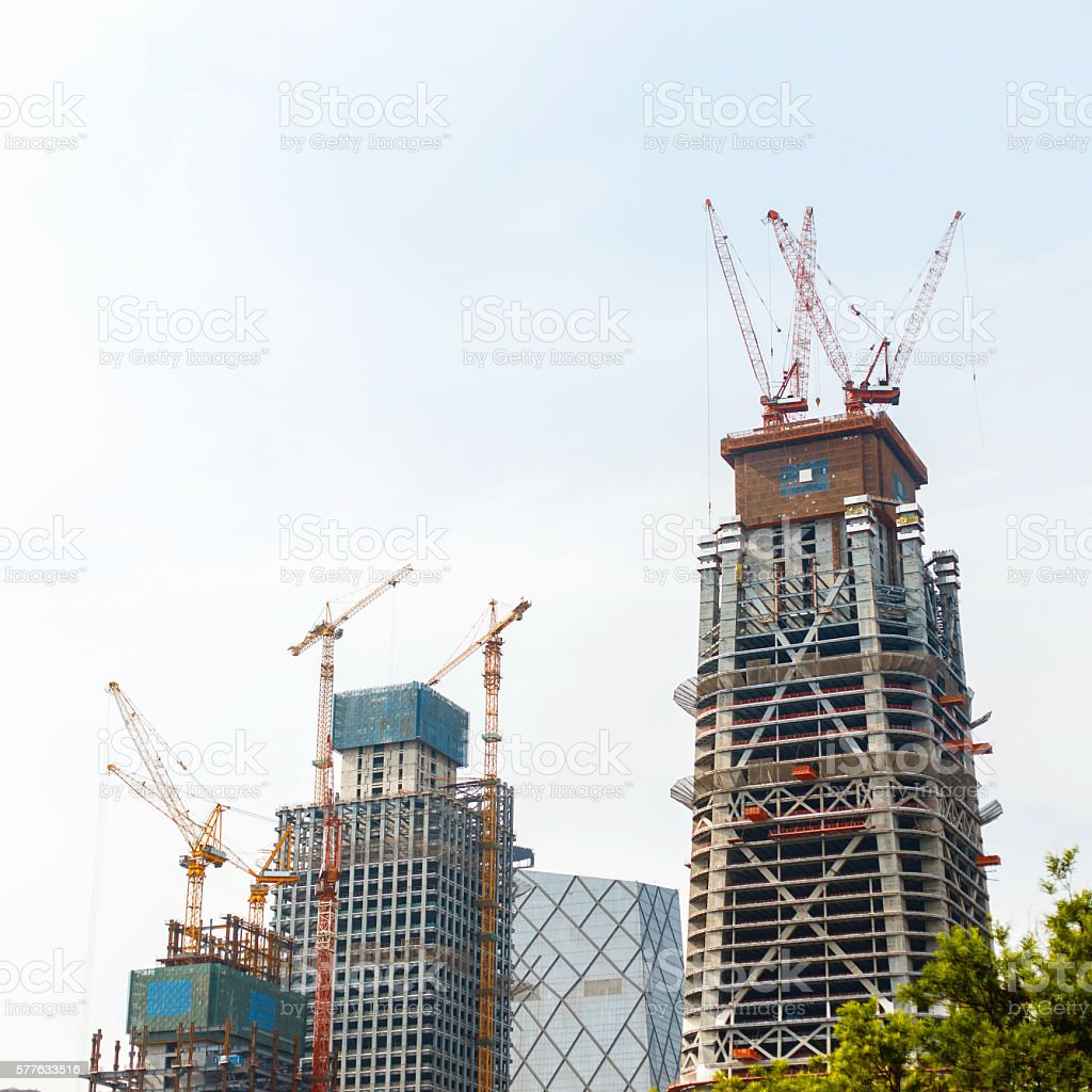 Modern construction. Crane building a new skyscraper. stock photo