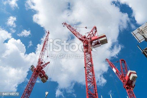 Modern Construction Cranes against sky, horizontal composition, copy space