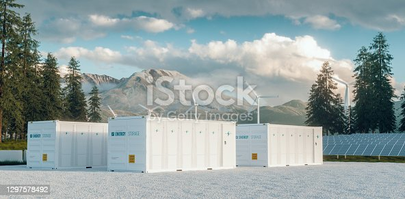 istock Modern container battery energy storage power plant system accompanied with solar panels and wind turbine system situated in nature with Mount St. Helens in background. 3d rendering. 1297578492