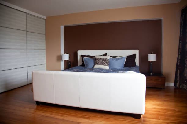 Modern contemporary apartment bedroom interior design after bamboo floors renovation stock photo